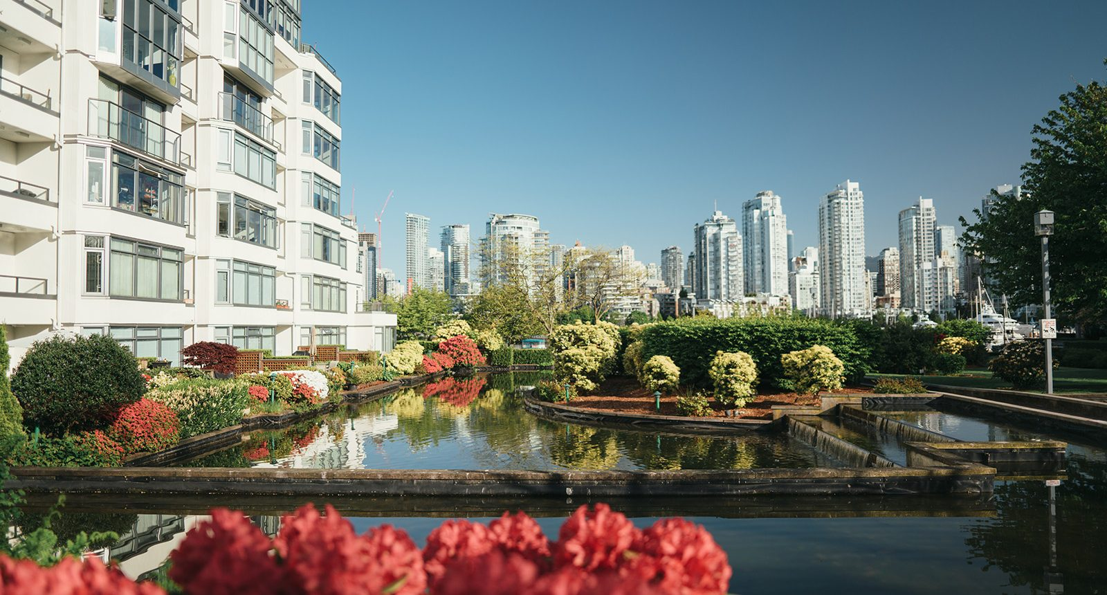 View of false creek buildings with fountain